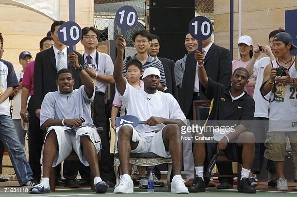 Joe Johnson LeBron James and Chris Paul of the USA Basketball Senior Mens National Team judge a slam dunk competition at a Nike court dedication on...
