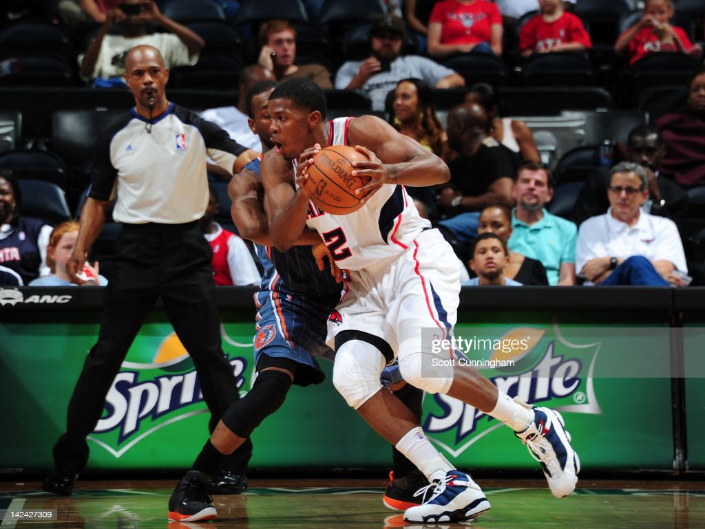 <a gi-track='captionPersonalityLinkClicked' href=/galleries/search?phrase=Joe+Johnson+-+Basketball+Player&family=editorial&specificpeople=201652 ng-click='$event.stopPropagation()'>Joe Johnson</a> #2 of the Atlanta Hawks controls the ball against <a gi-track='captionPersonalityLinkClicked' href=/galleries/search?phrase=Kemba+Walker&family=editorial&specificpeople=5042442 ng-click='$event.stopPropagation()'>Kemba Walker</a> #1 of the Charlotte Bobcats on April 4, 2012 at Philips Arena in Atlanta, Georgia.