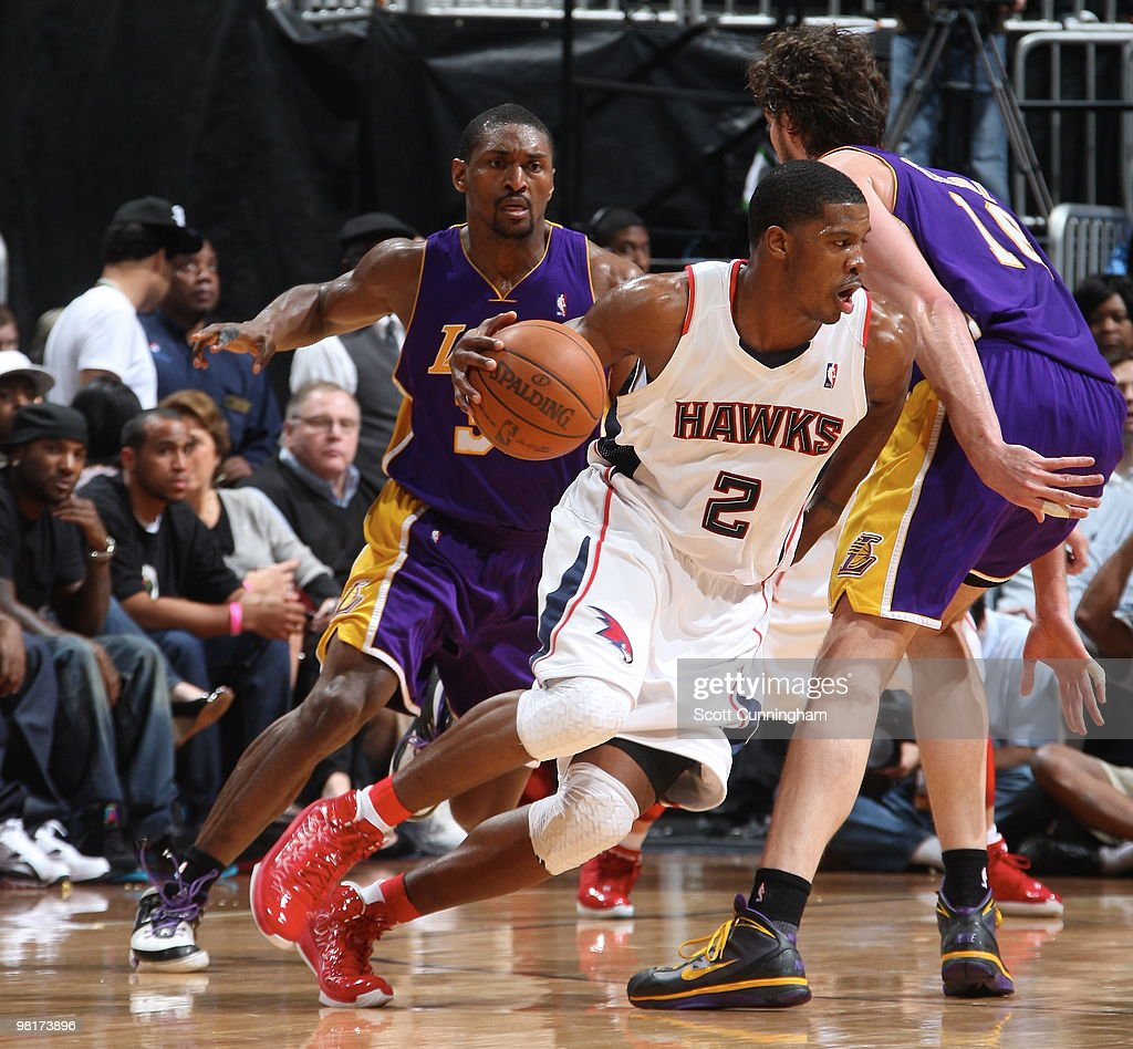 Joe Johnson of the Atlanta Hawks drives against Pau Gasol of the Los Angeles Lakers on March 31 2010 at Philips Arena in Atlanta Georgia NOTE TO USER...