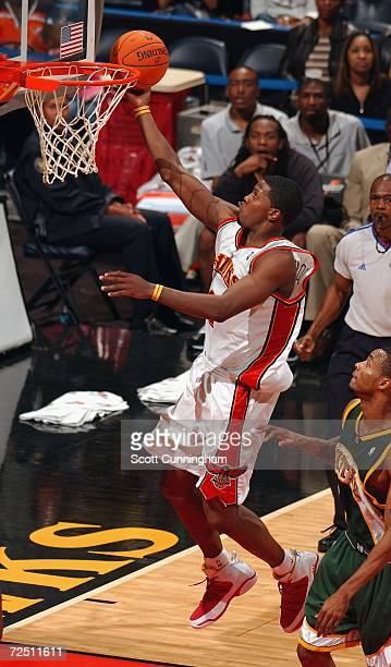 Joe Johnson of the Atlanta Hawks drives to the basket against the Seattle Sonics at Philips Arena on November 11 2006 in Atlanta Georgia NOTE TO USER...