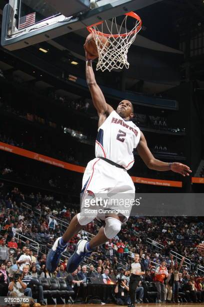 Joe Johnson of the Atlanta Hawks dunks against the San Antonio Spurs on March 21 2010 at Philips Arena in Atlanta Georgia NOTE TO USER User expressly...