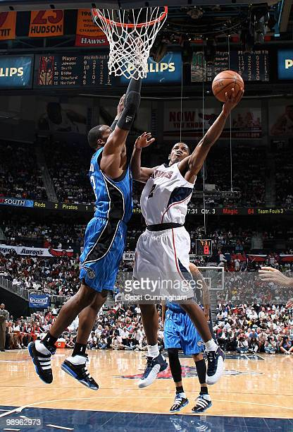 Joe Johnson of the Atlanta Hawks puts up a shot against Dwight Howard of the Orlando Magic in Game Four of the Eastern Conference Semifinals during...