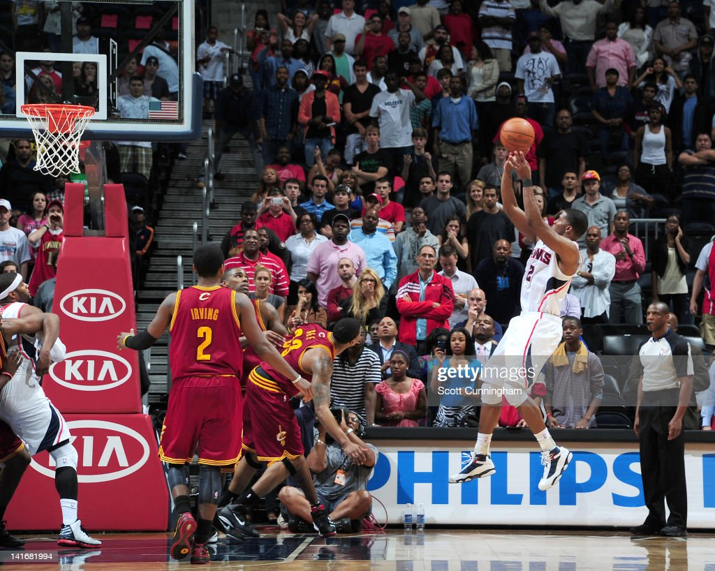 Joe Johnson of the Atlanta Hawks shoots a gamewinning shot during the game between the Atlanta Hawks and the Cleveland Cavaliers on March 21 2012 at...