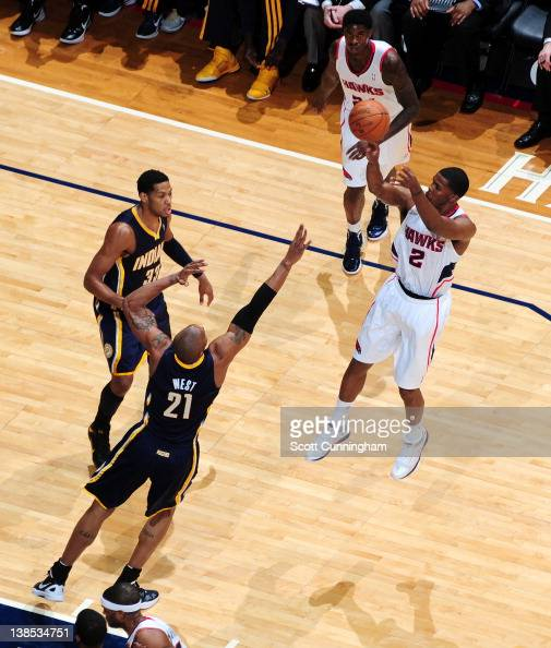Joe Johnson of the Atlanta Hawks shoots against David West of the Indiana Pacers on February 8 2012 at Philips Arena in Atlanta Georgia NOTE TO USER...