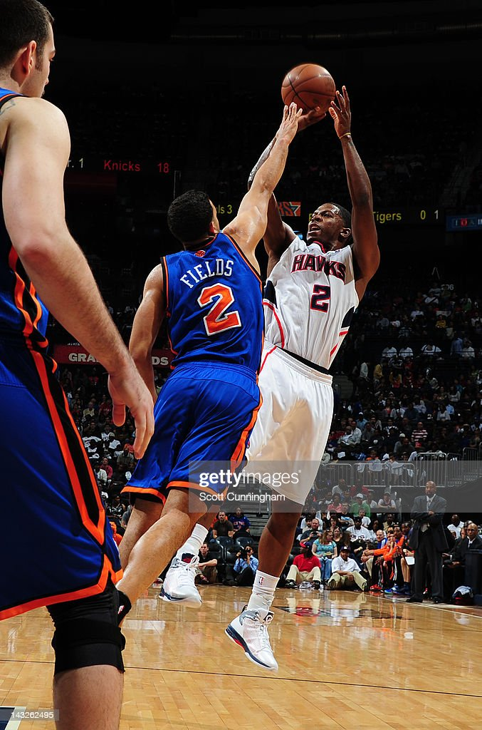 <a gi-track='captionPersonalityLinkClicked' href=/galleries/search?phrase=Joe+Johnson+-+Basketball+Player&family=editorial&specificpeople=201652 ng-click='$event.stopPropagation()'>Joe Johnson</a> #2 of the Atlanta Hawks shoots against <a gi-track='captionPersonalityLinkClicked' href=/galleries/search?phrase=Landry+Fields&family=editorial&specificpeople=4184645 ng-click='$event.stopPropagation()'>Landry Fields</a> #2 of the New York Knicks on April 22, 2012 at Philips Arena in Atlanta, Georgia.