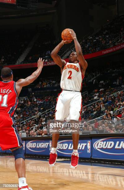 Joe Johnson of the Atlanta Hawks takes a shot against Antoine Wright of the New Jersey Nets on February 7 2007 at Philips Arena in Atlanta Georgia...