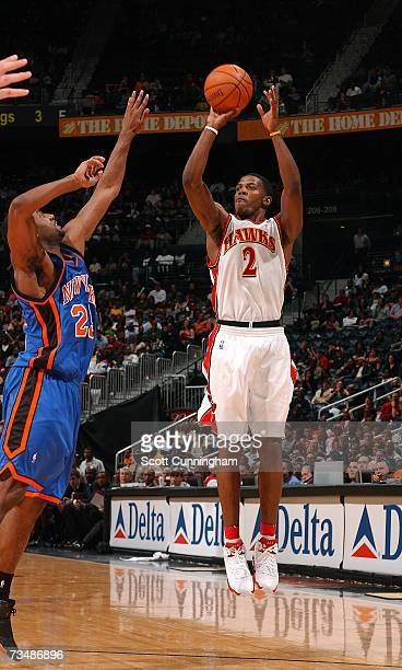 Joe Johnson of the Atlanta Hawks takes a shot against Mardy Collins of the New York Knicks at Philips Arena on March 3 2007 in Atlanta Georgia NOTE...