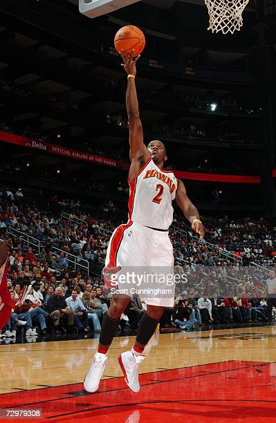Joe Johnson of the Atlanta Hawks takes the ball to the basket against the Cleveland Cavaliers during the game at Philips Arena on December 27 2006 in...