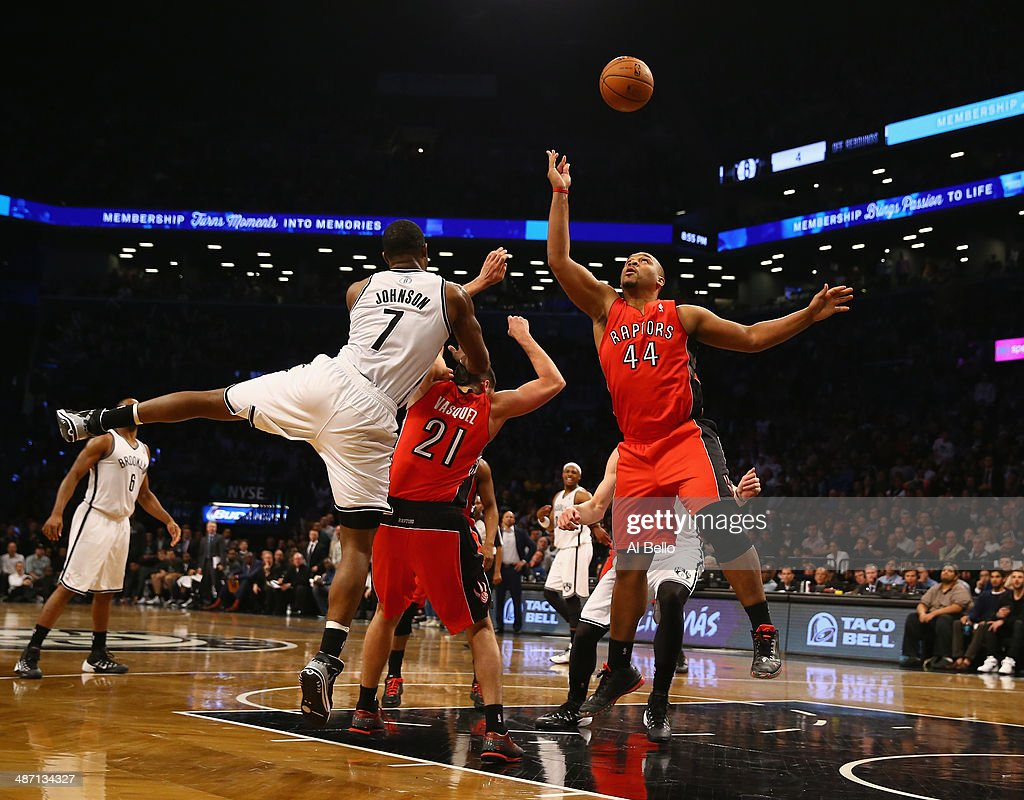 Joe Johnson #7 of the Brooklyn Nets and Chuck Hayes #44 of the Toronto Raptors go for a rebound in Game Four of the Eastern Conference Quarterfinals during the 2014 NBA Playoffs at the Barclays Center on April 27, 2014 in the Brooklyn borough of New York City.