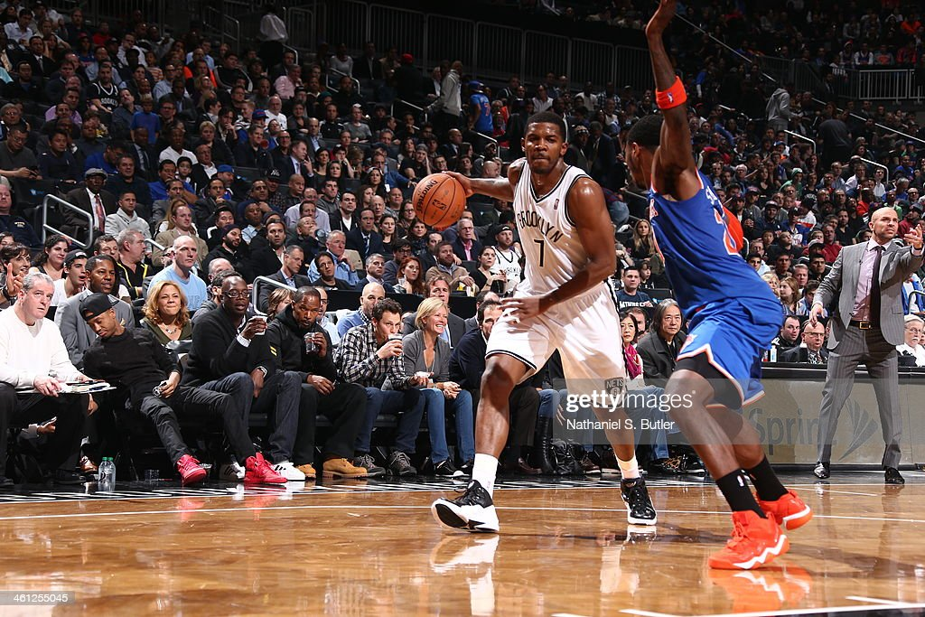 Joe Johnson #7 of the Brooklyn Nets being guarded by <a gi-track='captionPersonalityLinkClicked' href=/galleries/search?phrase=Iman+Shumpert&family=editorial&specificpeople=5042486 ng-click='$event.stopPropagation()'>Iman Shumpert</a> #21 of the New York Knicks during a game at Barclays Center on December 5, 2013 in the Brooklyn borough of New York City.