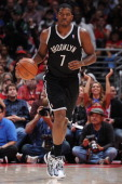 Joe Johnson of the Brooklyn Nets brings the ball up court during a game against the Los Angeles Clippers on November 16 2013 at STAPLES Center in Los...