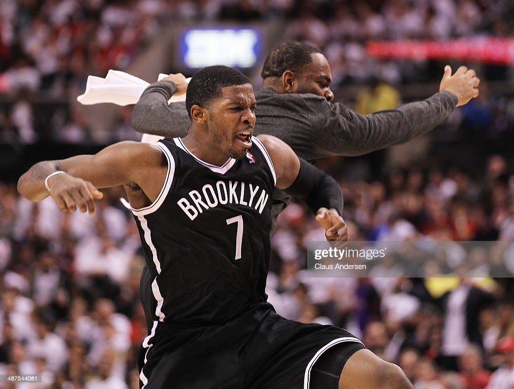 Joe Johnson #7 of the Brooklyn Nets celebrates a big 3 pointer against the Toronto Raptors in Game Five of the NBA Eastern Conference Quarterfinals at the Air Canada Centre on April 30, 2014 in Toronto, Ontario, Canada. The Raptors defeated the Nets 115-113 to take a 3-2 series lead.