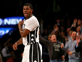 Joe Johnson of the Brooklyn Nets celebrates after teammate Bojan Bogdanovic hit a three pointer in the third overtime against the Milwaukee Bucks at...