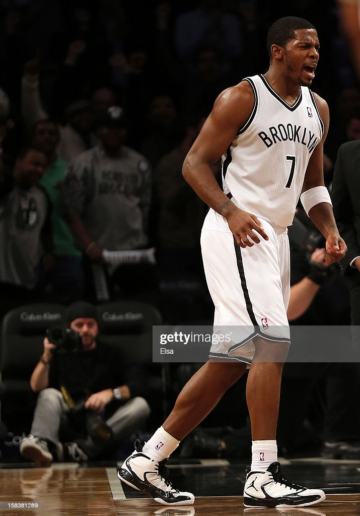 Joe Johnson #7 of the Brooklyn Nets celebrates his game winning basket over the Detroit Pistons on December 14, 2012 at the Barclays Center in the Brooklyn borough of New York City. The Brooklyn Nets defeated the Detroit Pistons 107-105 in double overtime.