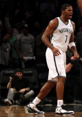 Joe Johnson of the Brooklyn Nets celebrates his game winning basket over the Detroit Pistons on December 14 2012 at the Barclays Center in the...