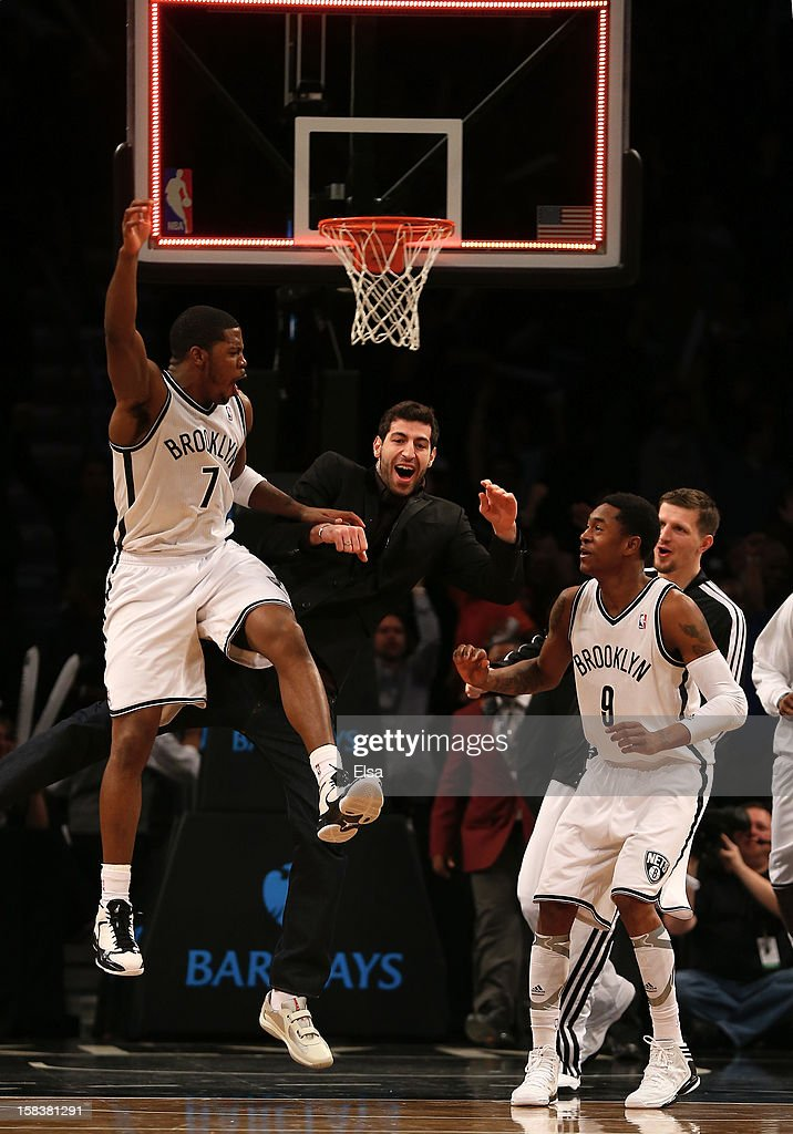<a gi-track='captionPersonalityLinkClicked' href=/galleries/search?phrase=Joe+Johnson+-+Basketball+Player&family=editorial&specificpeople=201652 ng-click='$event.stopPropagation()'>Joe Johnson</a> #7 of the Brooklyn Nets celebrates his game winning basket with teammate <a gi-track='captionPersonalityLinkClicked' href=/galleries/search?phrase=MarShon+Brooks&family=editorial&specificpeople=4884862 ng-click='$event.stopPropagation()'>MarShon Brooks</a> #3 in double overtime against the Detroit Pistons on December 14, 2012 at the Barclays Center in the Brooklyn borough of New York City. The Brooklyn Nets defeated the Detroit Pistons 107-105 in double overtime.