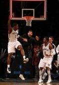 Joe Johnson of the Brooklyn Nets celebrates his game winning basket with teammate MarShon Brooks in double overtime against the Detroit Pistons on...