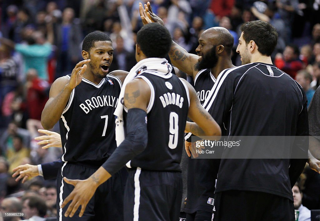 Joe Johnson #7 of the Brooklyn Nets celebrates with teammates after hitting the game winning shot in double overtime to give the Nets a 115-113 win over the Washington Wizards at Verizon Center on January 4, 2013 in Washington, DC.