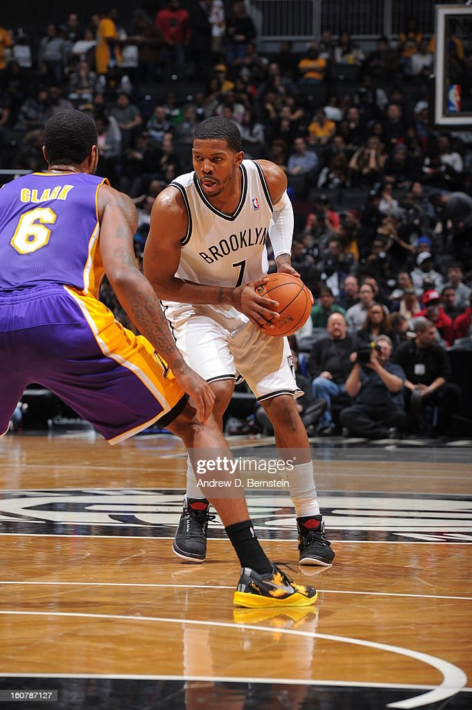 Joe Johnson #7 of the Brooklyn Nets controls the ball against Earl Clark #6 of the Los Angeles Lakers on February 5, 2013 at the Barclays Center in the Brooklyn borough of New York City.