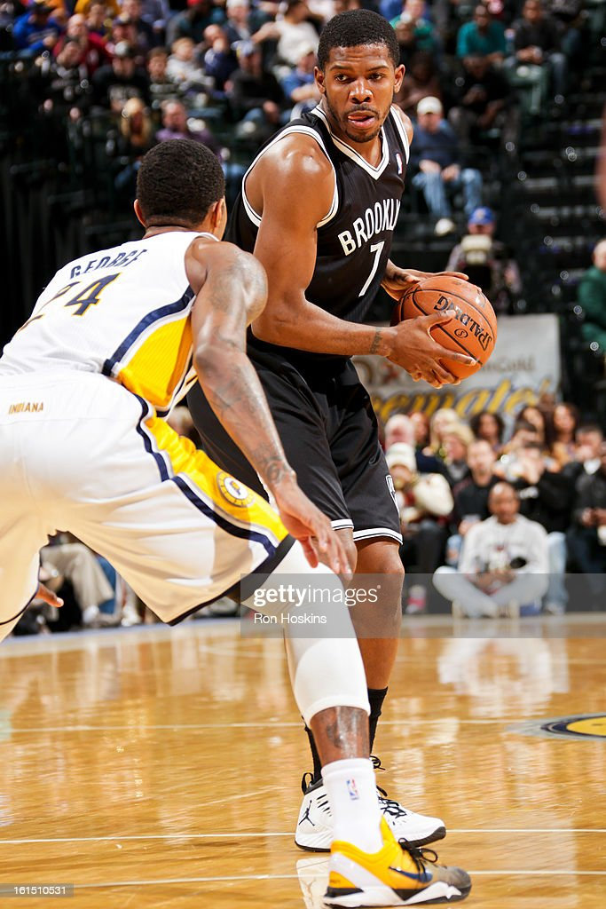 Joe Johnson #7 of the Brooklyn Nets controls the ball against Paul George #24 of the Indiana Pacers on February 11, 2013 at Bankers Life Fieldhouse in Indianapolis, Indiana.