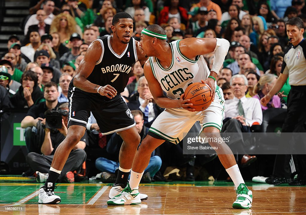 Joe Johnson #7 of the Brooklyn Nets defends against Paul Pierce #34 of the Boston Celtics on April 10, 2013 at the TD Garden in Boston, Massachusetts.