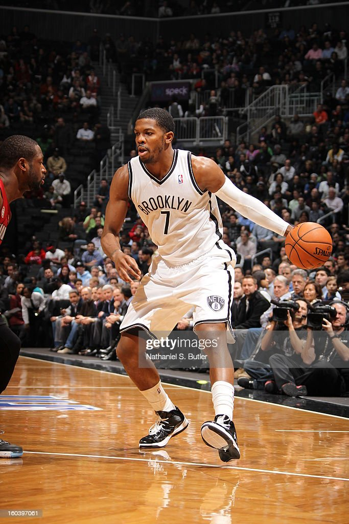 Joe Johnson #7 of the Brooklyn Nets dribbles against Dwyane Wade #3 of the Miami Heat on January 30, 2013 at the Barclays Center in the Brooklyn borough of New York City.