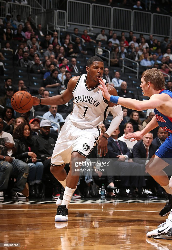 Joe Johnson #7 of the Brooklyn Nets dribbles against Kyle Singler #25 of the Detroit Pistons on April 17, 2013 at the Barclays Center in the Brooklyn borough of New York City.