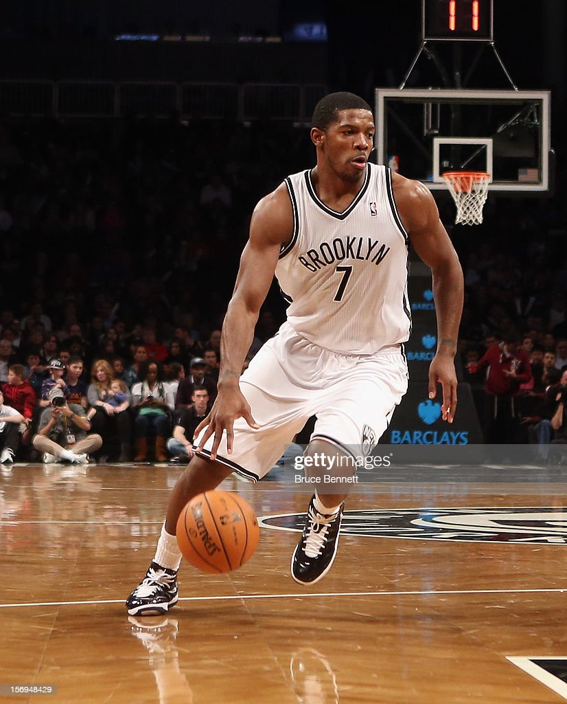 Joe Johnson #7 of the Brooklyn Nets dribbles the ball against the Portland Trail Blazers at the Barclays Center on November 25, 2012 in the Brooklyn borough of New York City.