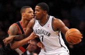Joe Johnson of the Brooklyn Nets drives against Damian Lillard of the Portland Trail Blazers during the second quarter at Barclays Center on November...
