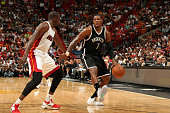 Joe Johnson of the Brooklyn Nets drives against Dwyane Wade of the Miami Heat on March 11 2015 at American Airlines Arena in Miami Florida NOTE TO...