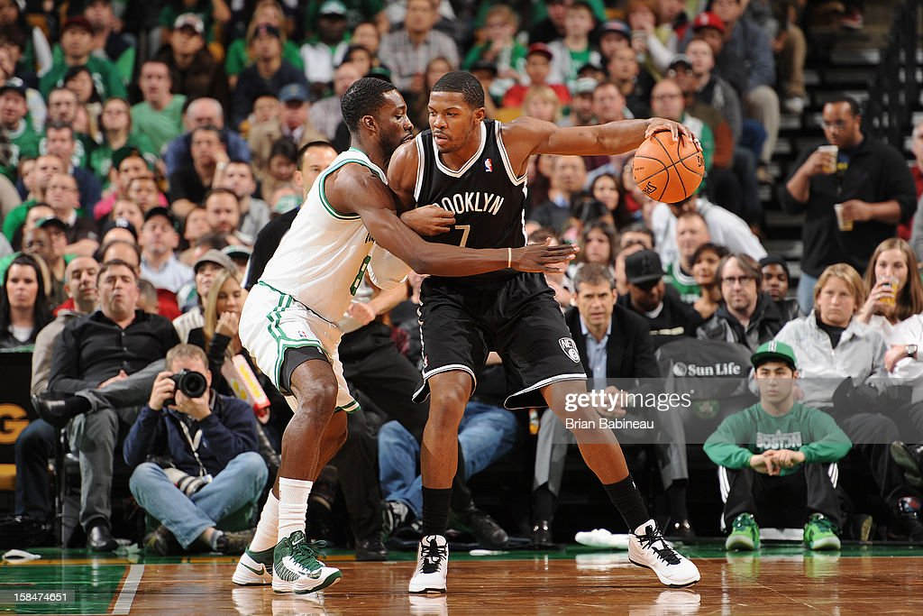 Joe Johnson #7 of the Brooklyn Nets drives against Jeff Green #8 of the Boston Celtics on November 28, 2012 at the TD Garden in Boston, Massachusetts.