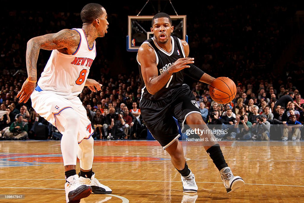 Joe Johnson #7 of the Brooklyn Nets drives against J.R. Smith #8 of the New York Knicks on January 21, 2013 at Madison Square Garden in New York City.