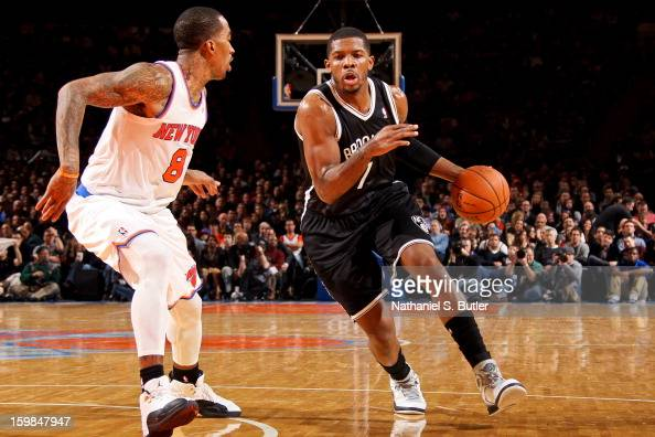 Joe Johnson of the Brooklyn Nets drives against JR Smith of the New York Knicks on January 21 2013 at Madison Square Garden in New York City NOTE TO...