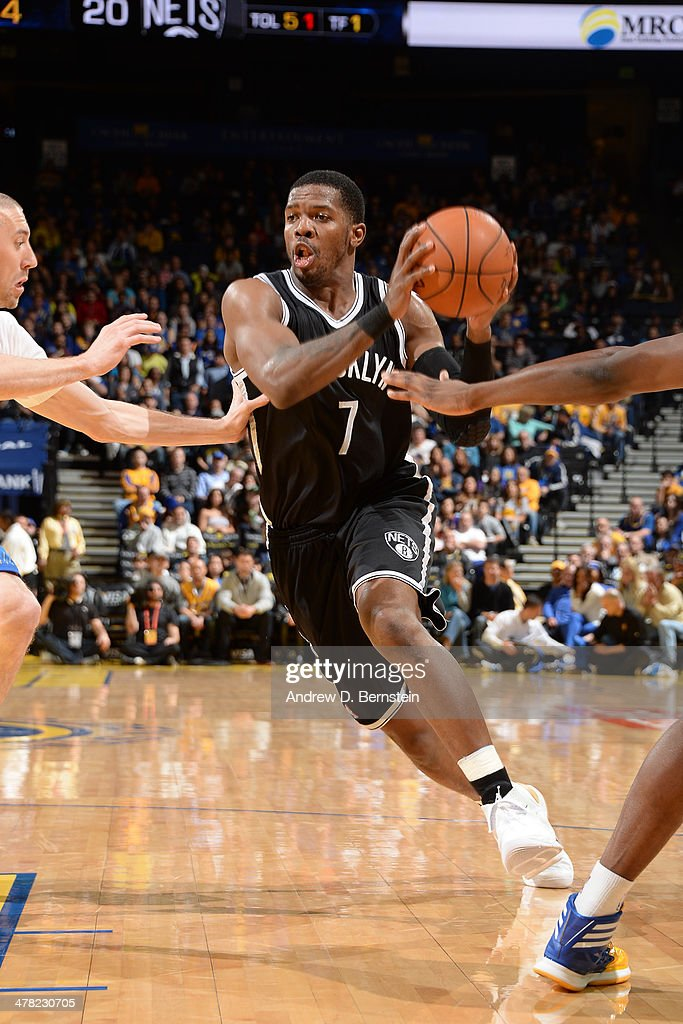 Joe Johnson #7 of the Brooklyn Nets drives against the Golden State Warriors at Oracle Arena on February 22, 2014 in Oakland, California.