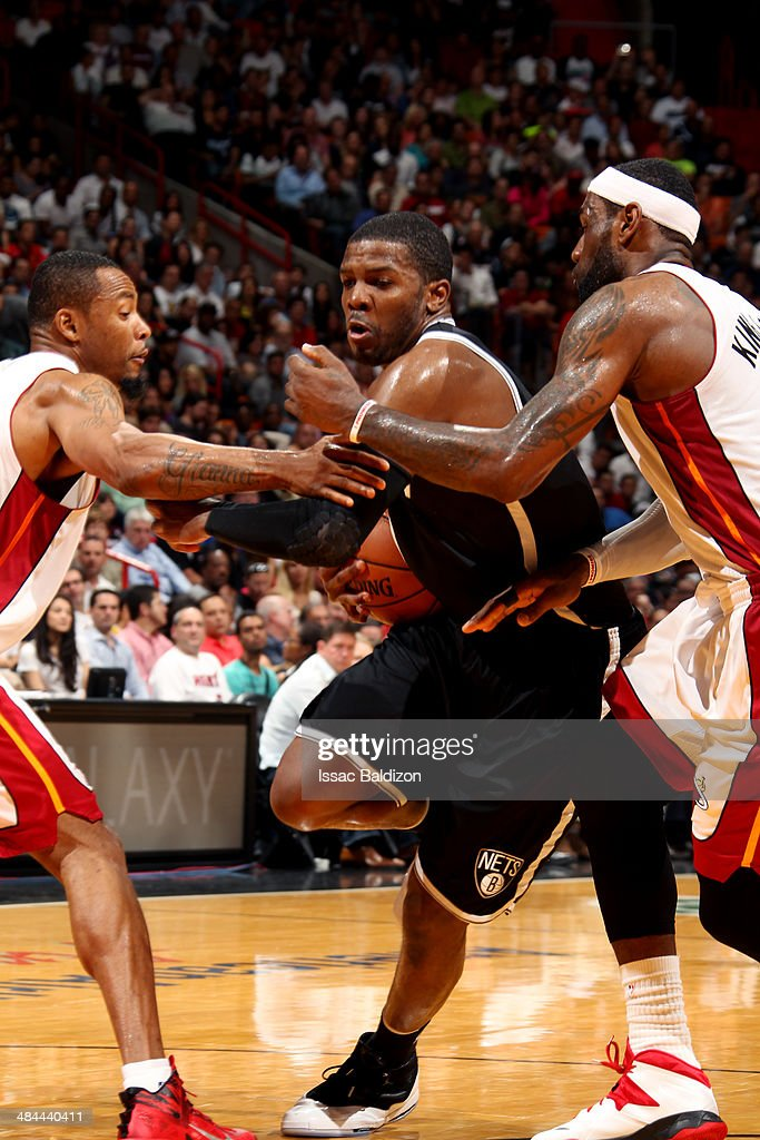 Joe Johnson #7 of the Brooklyn Nets drives against the Miami Heat at the American Airlines Arena in Miami, Florida on April, 8 2014.