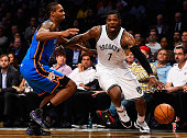 Joe Johnson of the Brooklyn Nets drives the ball past Lance Thomas of the Oklahoma City Thunder in the second half at the Barclays Center on November...