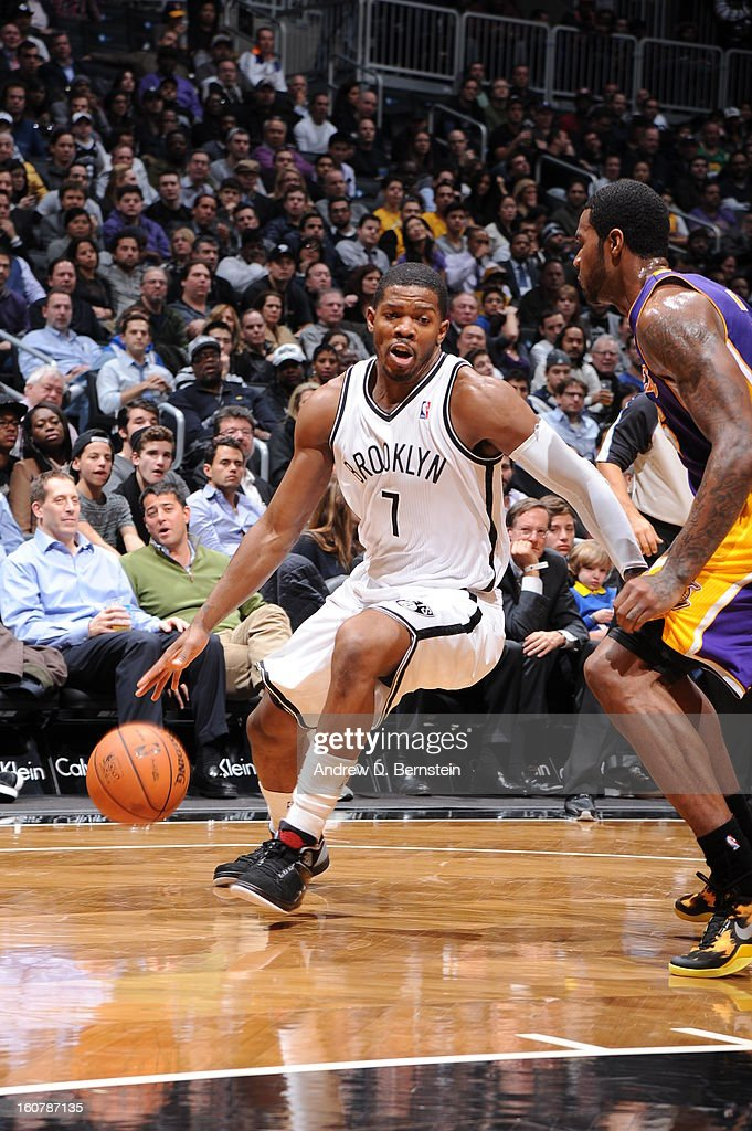 Joe Johnson #7 of the Brooklyn Nets drives to the basket against Earl Clark #6 of the Los Angeles Lakers on February 5, 2013 at the Barclays Center in the Brooklyn borough of New York City.