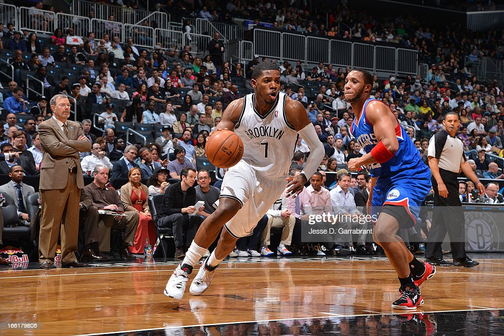 Joe Johnson #7 of the Brooklyn Nets drives to the basket against Evan Turner #12 of the Philadelphia 76ers on April 9, 2013 at the Barclays Center in Brooklyn, New York.