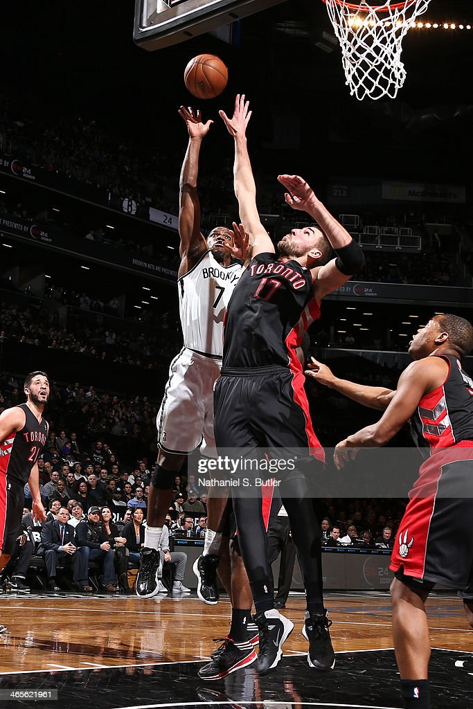 Joe Johnson #7 of the Brooklyn Nets drives to the basket against <a gi-track='captionPersonalityLinkClicked' href=/galleries/search?phrase=Jonas+Valanciunas&family=editorial&specificpeople=5654195 ng-click='$event.stopPropagation()'>Jonas Valanciunas</a> #17 of the Toronto Raptors during a game at Barclays Center in Brooklyn.
