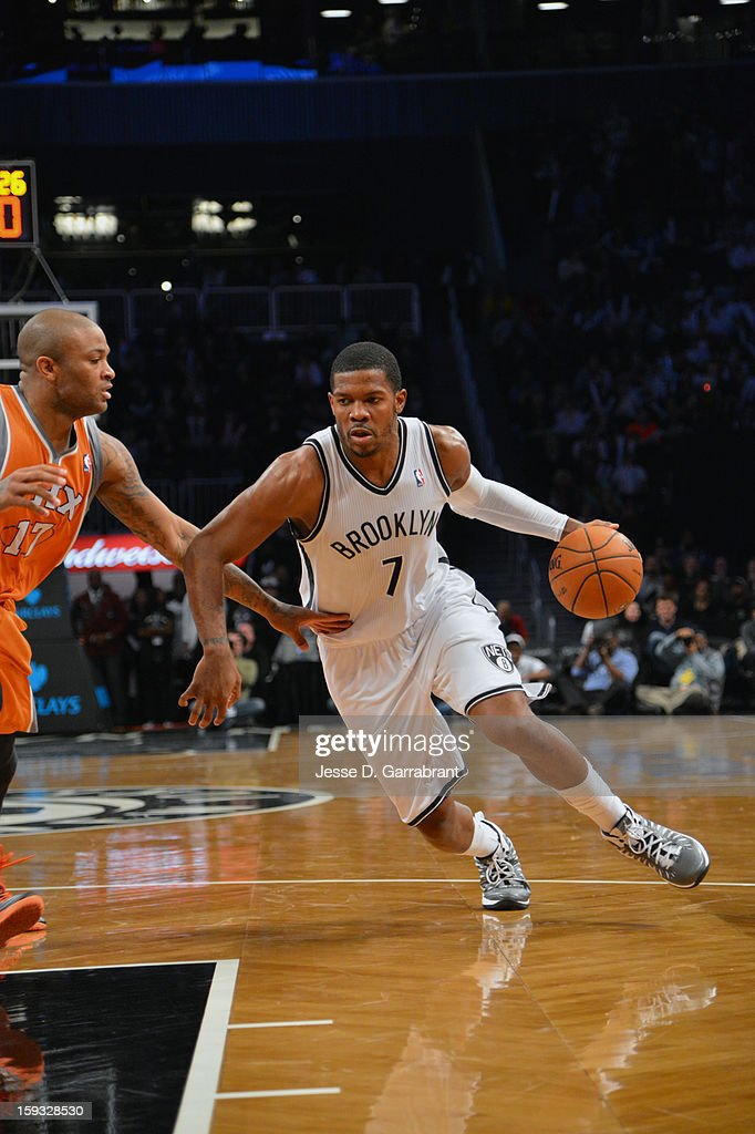 Joe Johnson #7 of the Brooklyn Nets drives to the basket against P.J. Tucker #17 of the Phoenix Suns during the game at the Barclays Center on January 11, 2013 in Brooklyn, New York.