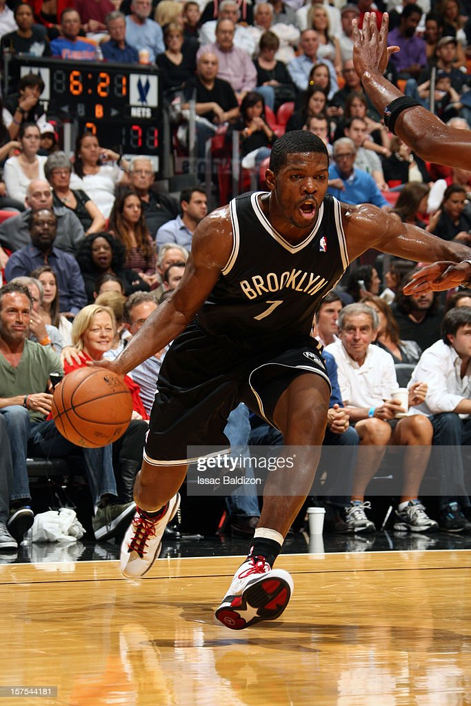 Joe Johnson #7 of the Brooklyn Nets drives to the basket against the Miami Heat on December 1, 2012 at American Airlines Arena in Miami, Florida.