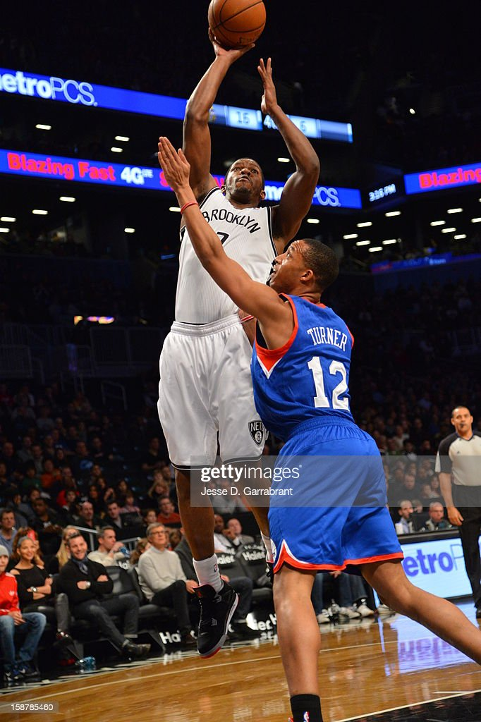 Joe Johnson #7 of the Brooklyn Nets drives to the basket against the Philadelphia 76ers at the Barclays Center on December 23, 2012 in Brooklyn, New York.