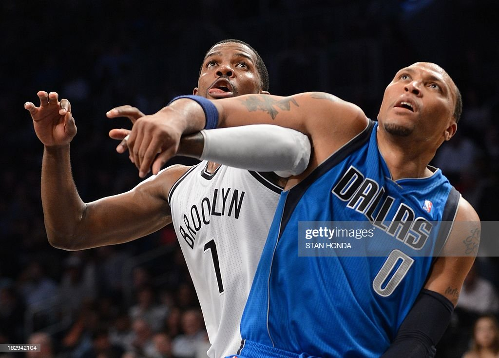 Joe Johnson (L) of the Brooklyn Nets fights for position under the basket against Shawn Marion (R) of the Dallas Mavericks at the Barclays Center March 1, 2013 in the Brooklyn borough of New York. The Mavericks won, 98-90. AFP PHOTO/Stan HONDA