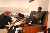 Joe Johnson of the Brooklyn Nets gets taped before the game against the Chicago Bulls in Game Two of the Eastern Conference Quarterfinals during the...