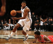 Joe Johnson of the Brooklyn Nets goes around Jimmy Butler of the Chicago Bulls in the second half during Game Seven of the Eastern Conference...