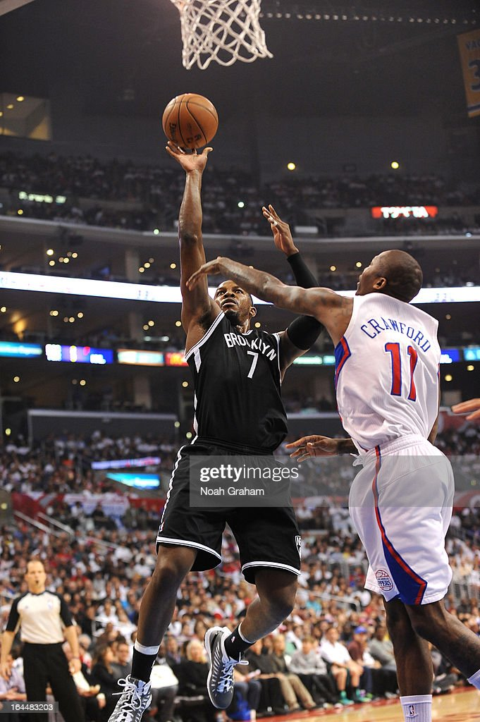 Joe Johnson #7 of the Brooklyn Nets goes to the basket against Jamal Crawford #11 of the Los Angeles Clippers during the game between the Los Angeles Clippers and the Brooklyn Nets at Staples Center on March 23, 2013 in Los Angeles, California.