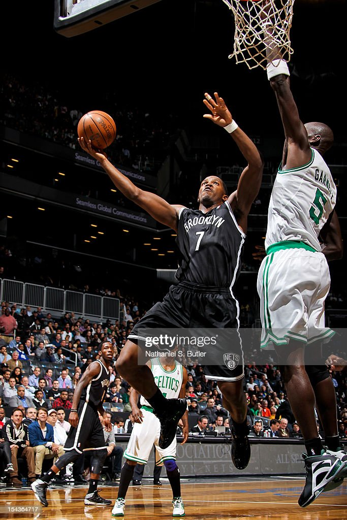 Joe Johnson #7 of the Brooklyn Nets goes to the basket against Kevin Garnett #5 of the Boston Celtics during a pre-season game on October 18, 2012 at the Barclays Center in the Brooklyn borough of New York City.