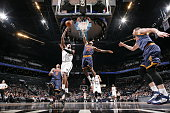 Joe Johnson of the Brooklyn Nets goes to the basket against LeBron James of the Cleveland Cavaliers on March 27 2015 at the Barclays Center in the...
