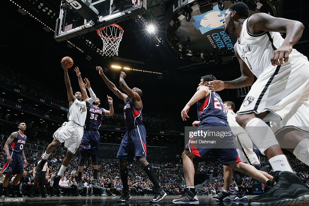 Joe Johnson #7 of the Brooklyn Nets goes up in traffic against the Atlanta Hawks at the Barclays Center on January 18, 2013 in the Brooklyn borough of New York City in New York City.