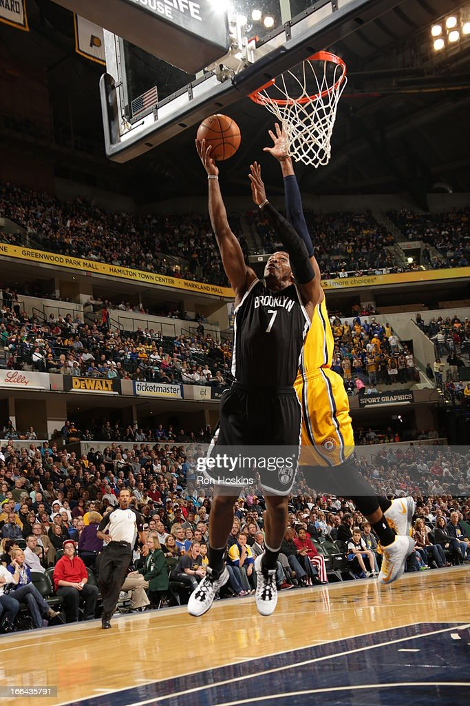 Joe Johnson #7 of the Brooklyn Nets goes up strong to the basket against the Indiana Pacers on April 12, 2013 at Bankers Life Fieldhouse in Indianapolis, Indiana.